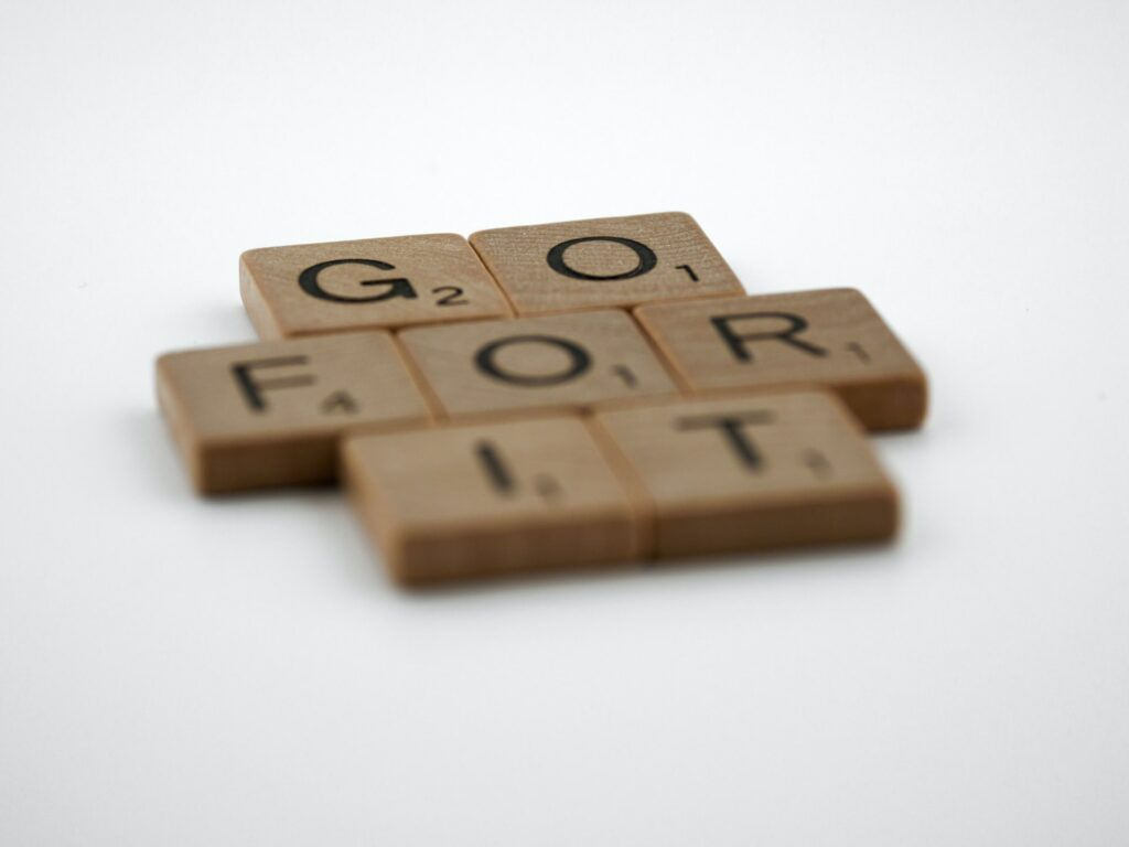 Scrabble tiles spelling the words go for it
